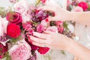 hands touching flowers