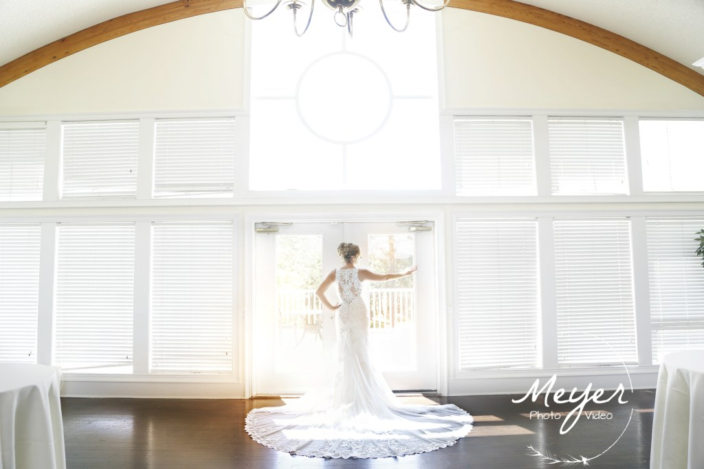 bride looking out bright window