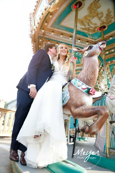 bride and groom on carousel smithville nj