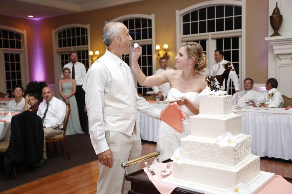couple sharing wedding cake