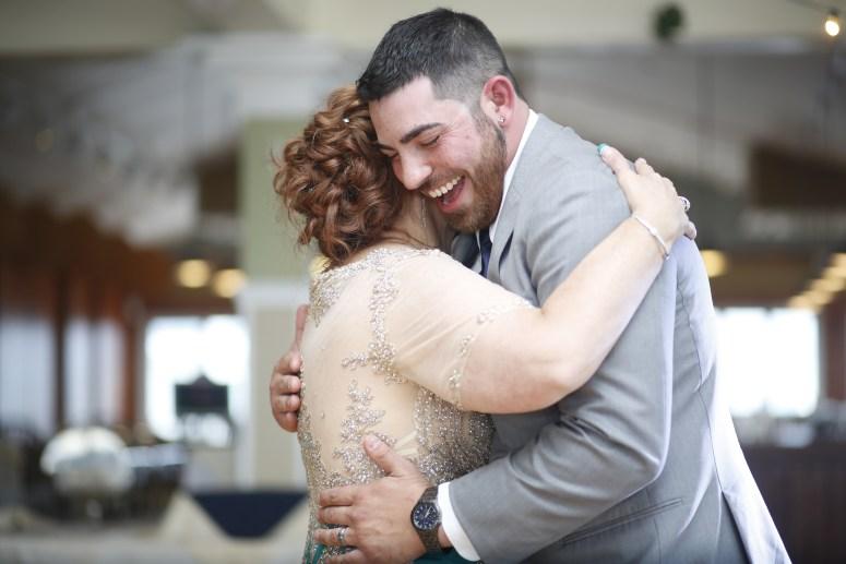 groom dancing with bridesmaid
