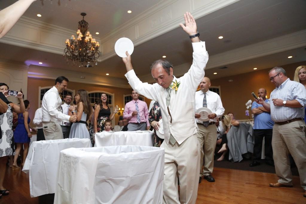 greek plate smashing at wedding
