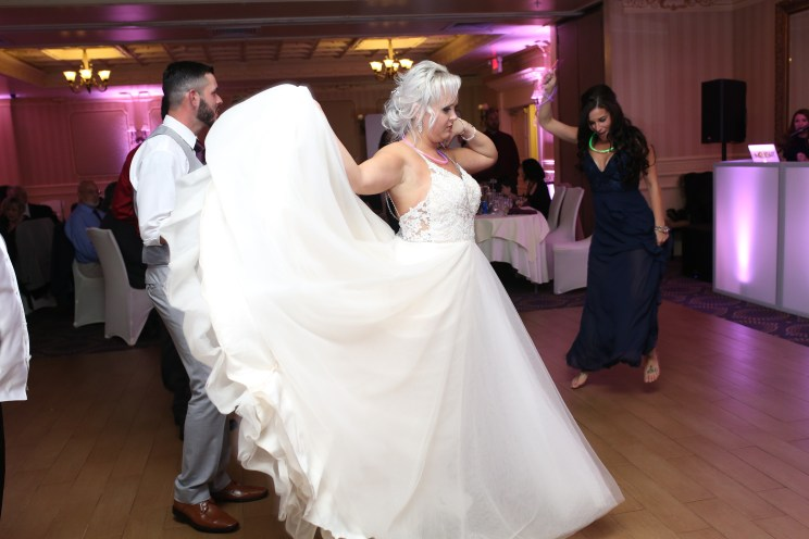 bride dancing and pretty dress