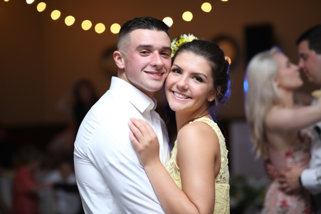 smiling couple at a wedding