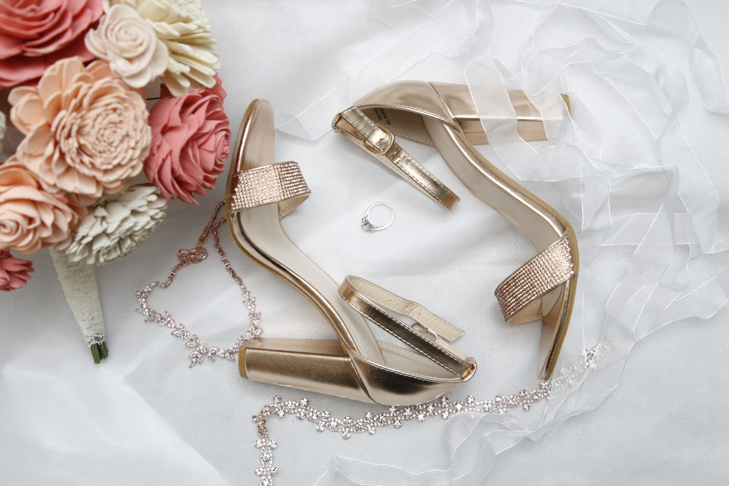 bouquet and heels with ring and necklaces at wedding in 2019