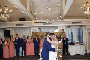 bride and groom dancing and kissing at wedding in 2019