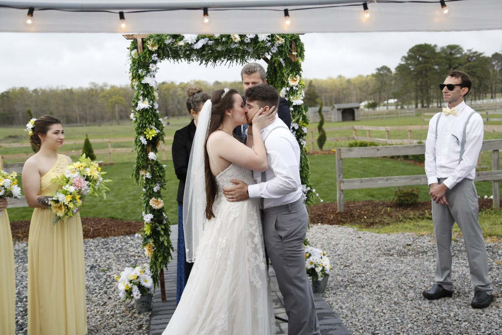 bride kissing groom at the altar in NJ