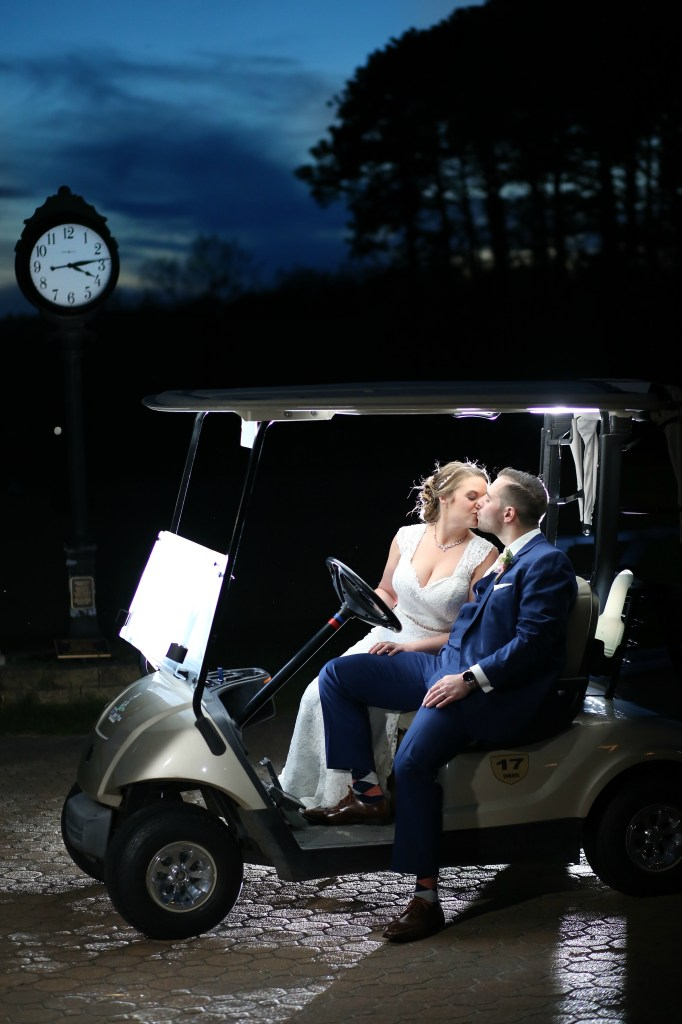 bride kissing groom in golf cart at night in NJ