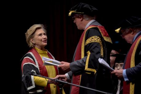 US politician Hillary Rodham Clinton, left, receives a Honorary Doctorate by Pro-Chancellor Roderick Evans, at Swansea University, in recognition of her commitment to promoting the rights of families and children around the world, in Swansea, Wales, Saturday, Oct. 14, 2017. (Ben Birchall/PA via AP)