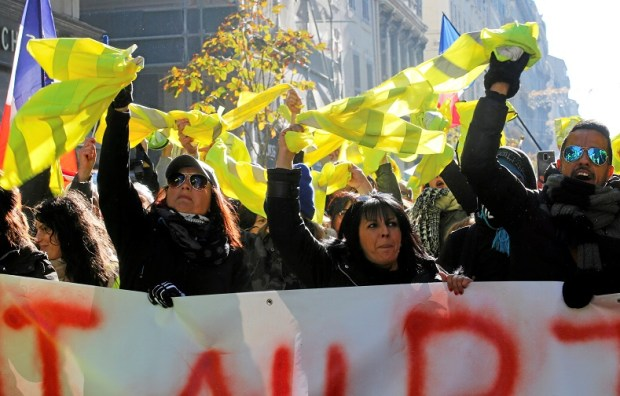 """Protesters hold yellow vests as they take part in a demonstration of the """"yellow vests"""" movement in Marseille"""