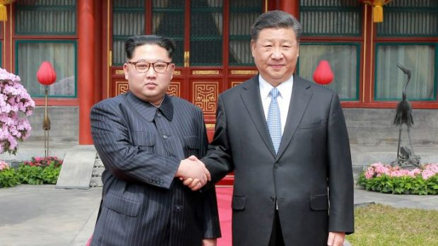 Kim Jong Un and Xi Jinping.jpg
