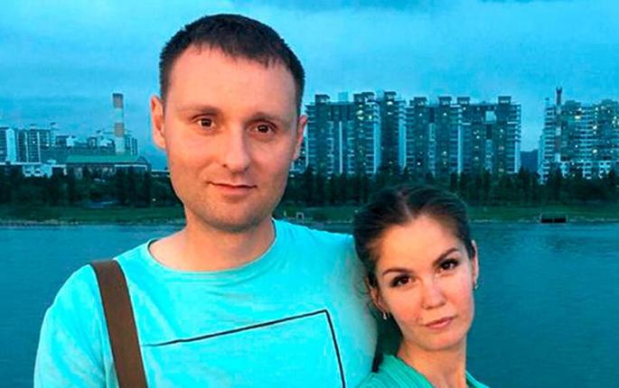 Mikhail Popov and his wife Yelena pose