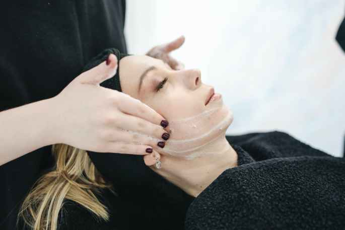 woman having facial care