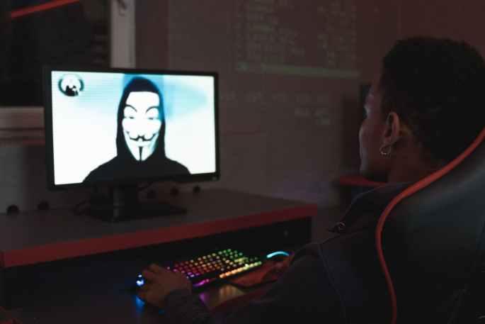man in black hoodie having a video call