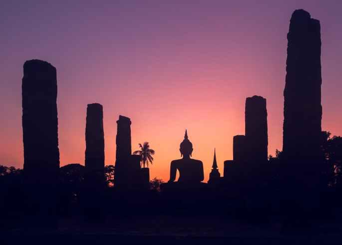 majestic sunset sky over big buddha statue