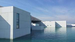 Canva - White Building Surrounded With Water - Turismo Abogados Perú