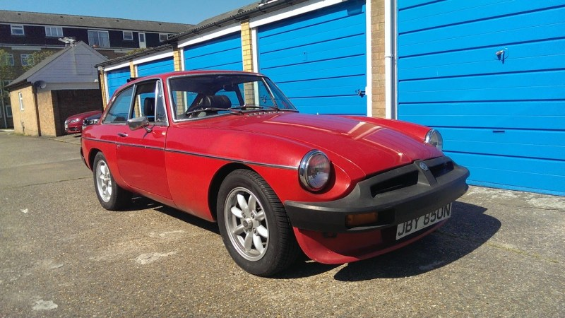 Red MGB GT pictured from the front