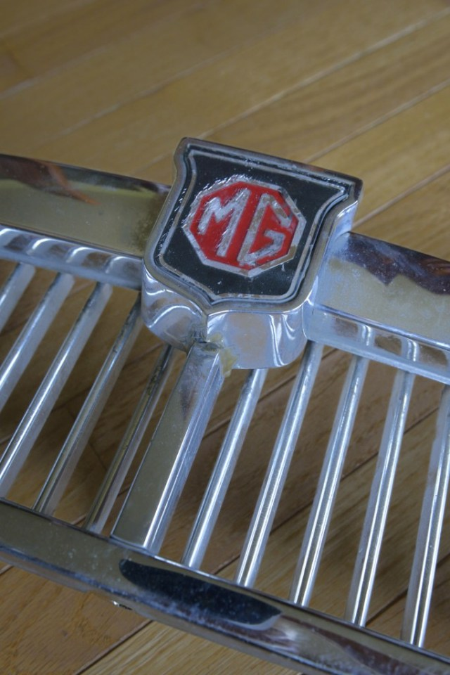 The original 67 MGB GT emblem showing 48 years of age