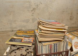 Old Road & Track magazines sitting on top of some serious vinyl