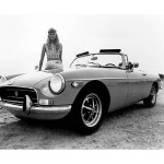 1970 MG MGB convertible with hippie chick