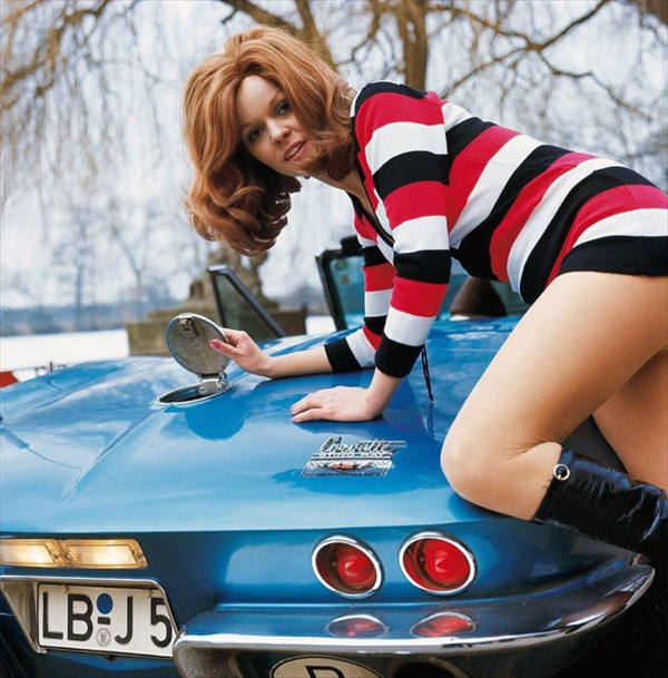 Corvette with girl climbing on trunk