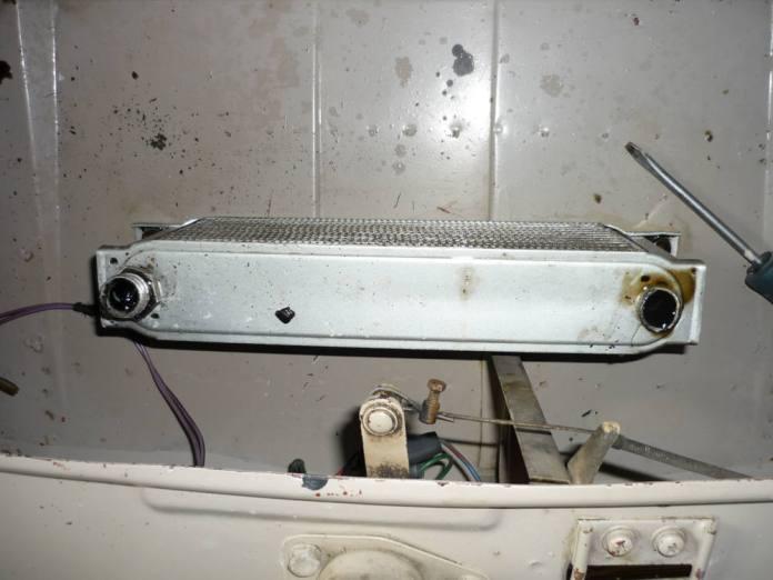 Damaged MGB GT oil cooler