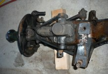 MGB GT front suspension is removed from car