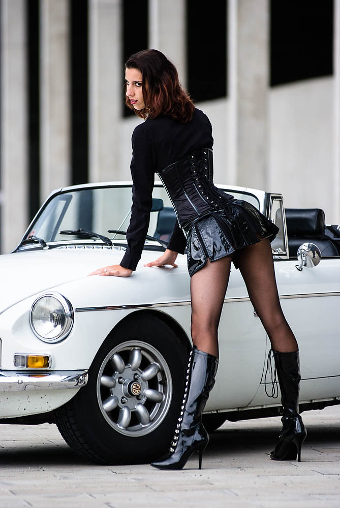 MGB with gal in mini skirt