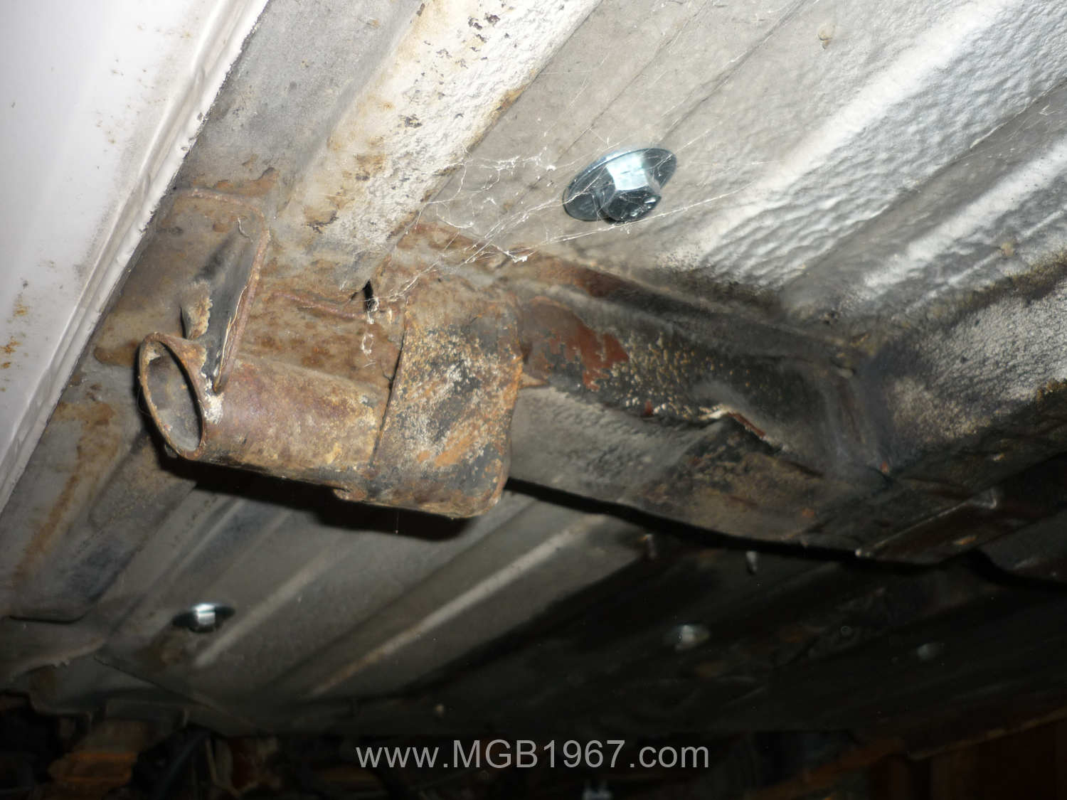 MGB GT frame rail after wire brush