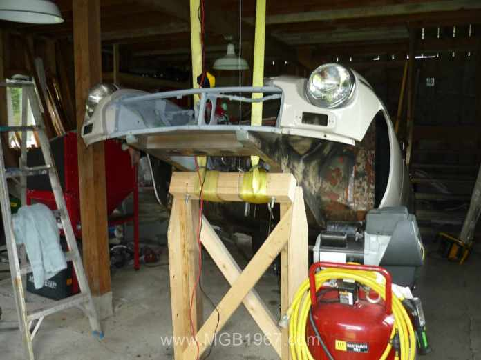 MGB GT hoisted up in the barn