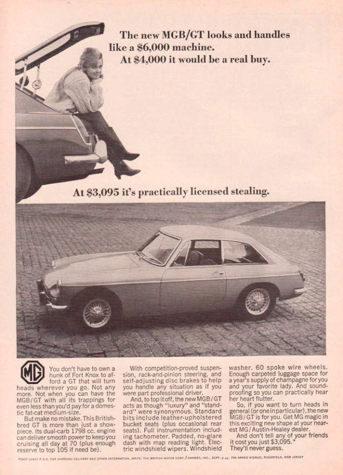 Women in MGB GT trunk