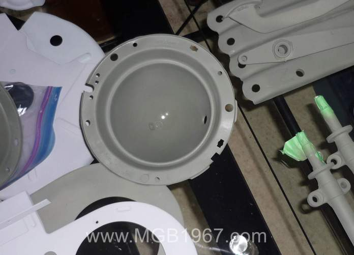 Primed MGB headlight bucket