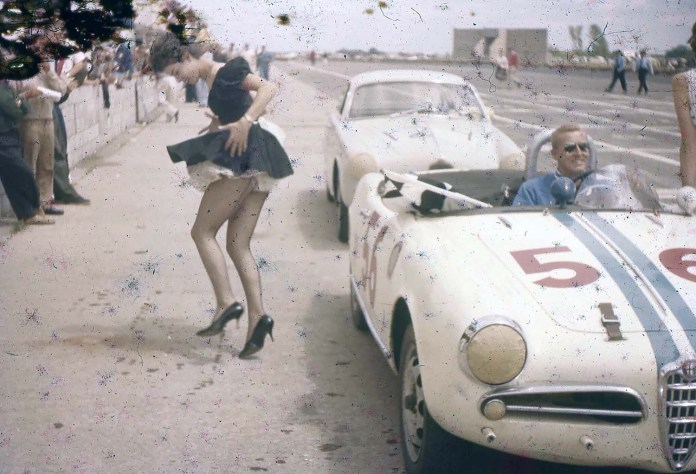 Alfa Giulietta Spyder Veloce with female distraction leaving