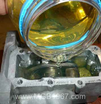 Adding oil to the MGB Armstrong lever shock