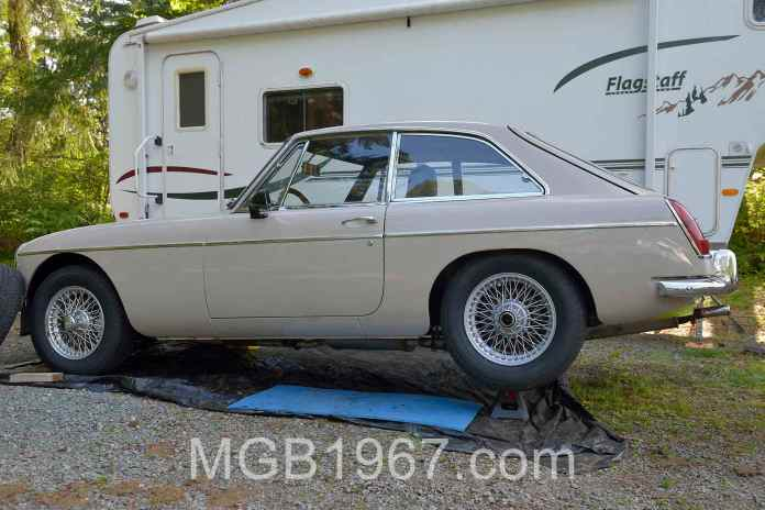 MGB GT with newly painted rear wire rim