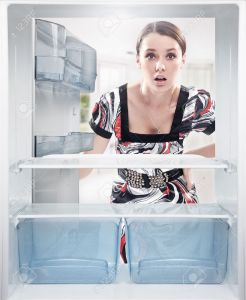 9068061-Young-woman-looking-on-empty-shelf-in-fridge--Stock-Photo-refrigerator