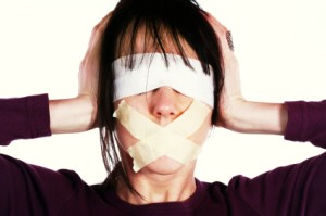 Censor and freedom of speech concept. Media prisoner and human rights concept. Tied mouth and blindfolded eyes.