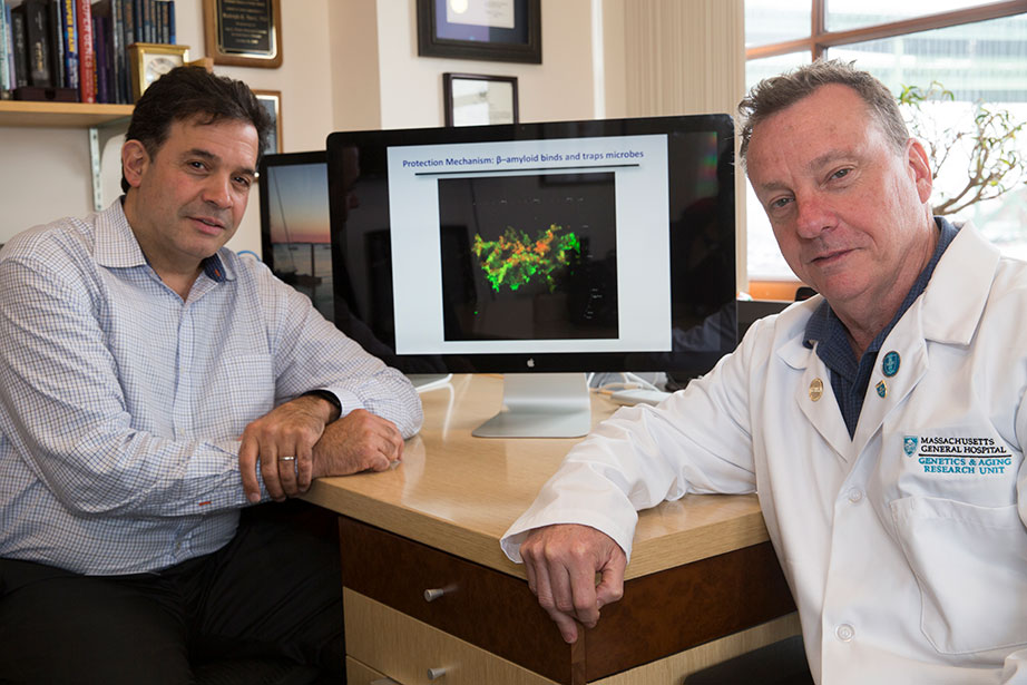 Alzheimer's researchers Rudy Tanzi, left, and Robert Moir are working on finding an infectious cause of Alzheimer's disease.