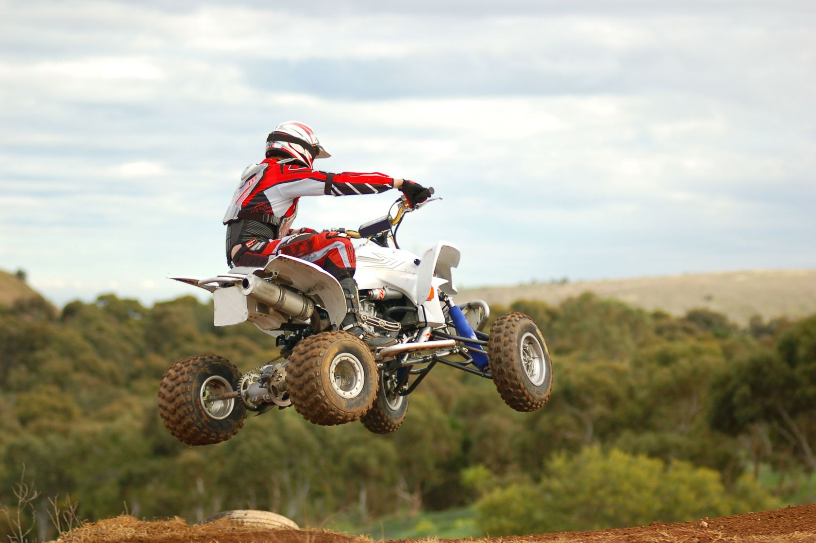 2463793 - quad bike racer jumping into corner away from camera