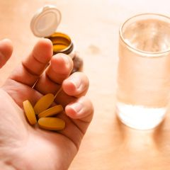 22384936 - hand holding yellow pills