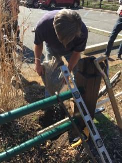 Doug prepares the foundations for the arbor.