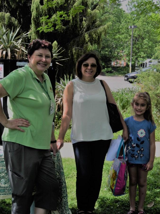 Audubon Ambassador (and Master Gardener volunteer) Alyssa Ford Morel with two visitors to Simpson's Gardening for Birds open house.