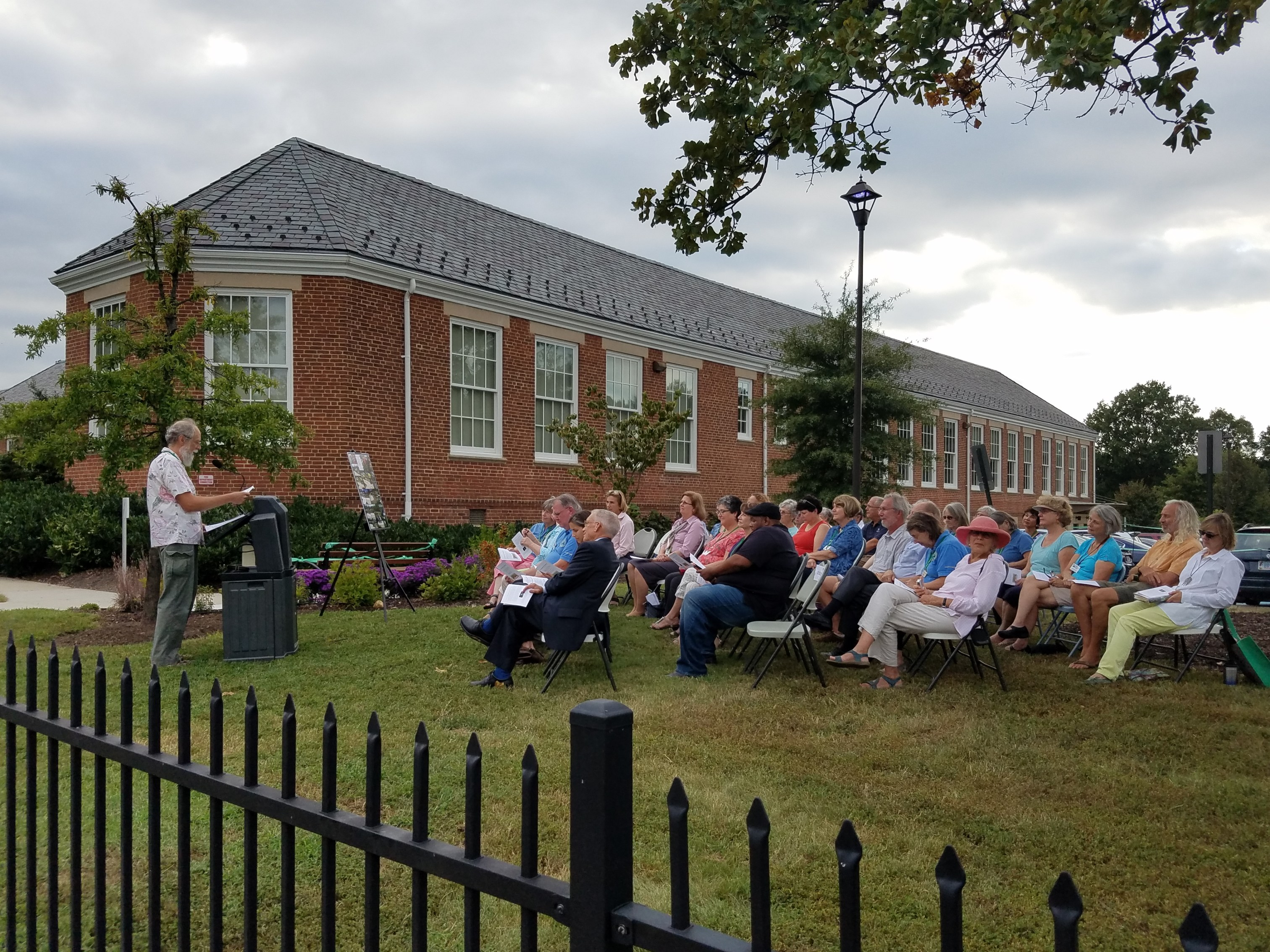 Master Gardeners and guests listening to Peter Hickmand at dedication ceremony