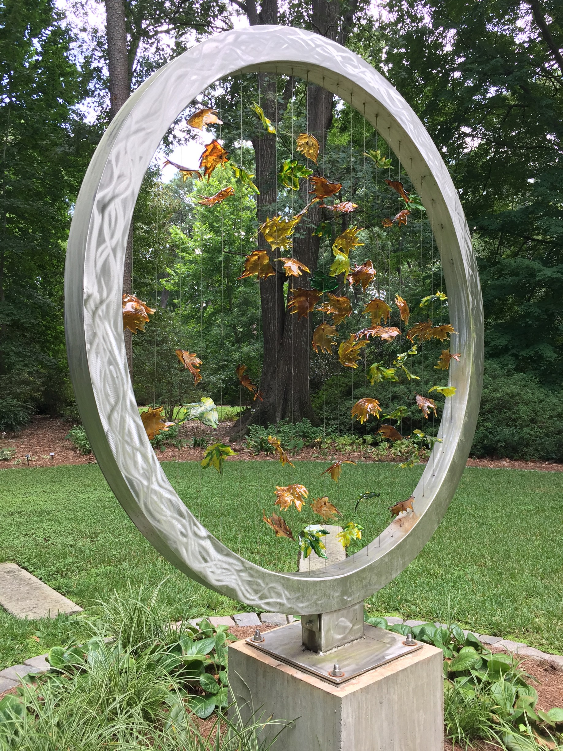 A beautiful art piece with falling leaves in the Reflection Garden. Photo © 2018 Elaine Mills.