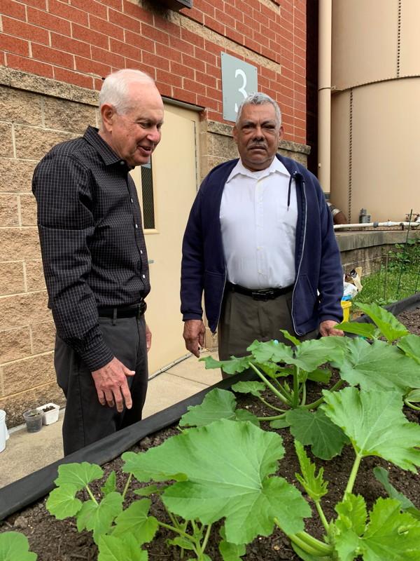 Two senior participants discuss the plants' progress Photo © 2019 Lynn Berry