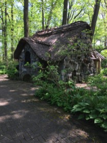 The Faerie Cottage incorporates iron and stone elements from earlier gardens.