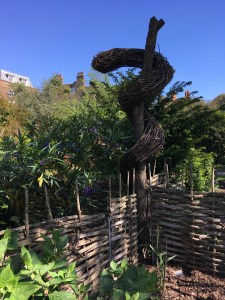Rod of Asclepius sculpture at Chelsea Physic Garden, London, England Photo © 2019 Nancy Smith Brooks