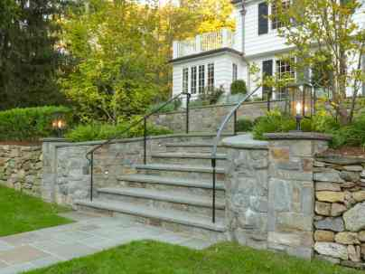 """New stone walls, lights, railings, steps and paths marry well with the existing stone retaining wall. Notice how the walkway widens out to become the landing for ever narrowing steps."" p. 29. Photo © Susan Teare"