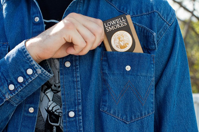 Pack of Lowell Smokes in jean jacket pocket