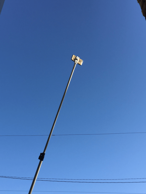 Cell Phone Camera in use in a phone adapter on a Camera Pole